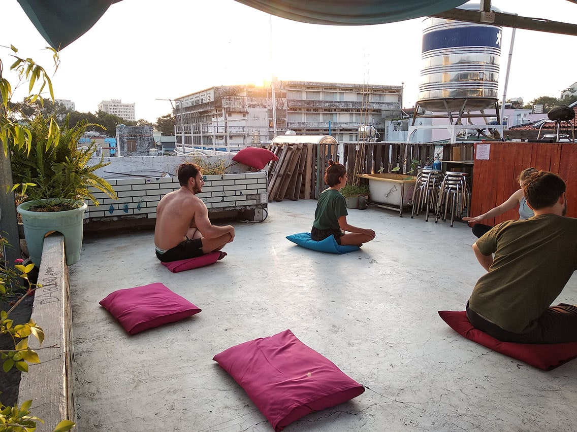 Yoga rooftop morning saigon Dablend Hostel